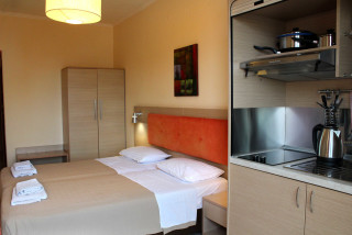 standard studio philoxenia hotel double bedroom